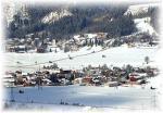 Část obce Haus im Ennstal v zimě